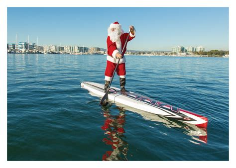 day care santa paddle boarding santa tag palm press