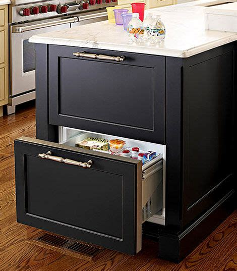 kitchen island with refrigerator housing a set of refrigerator drawers in an island extends