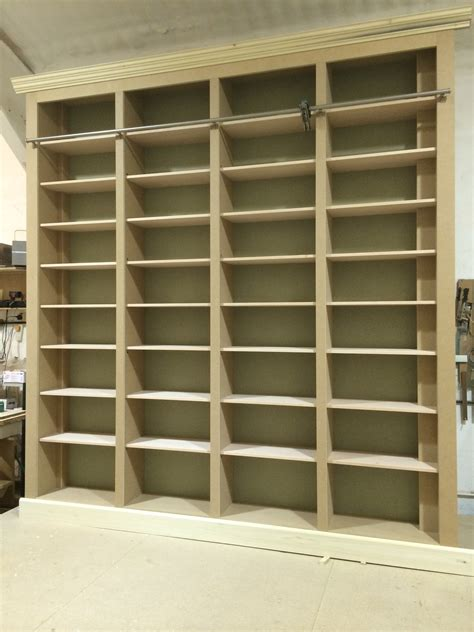 bespoke large fitted bookcase with solid beech shelves
