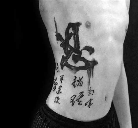 writing tattoos on ribs for men 75 tattoos for masculine design ideas