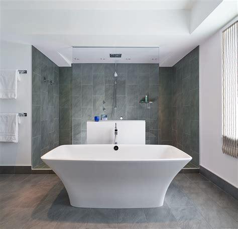 large walk  doorless shower  gray tiles