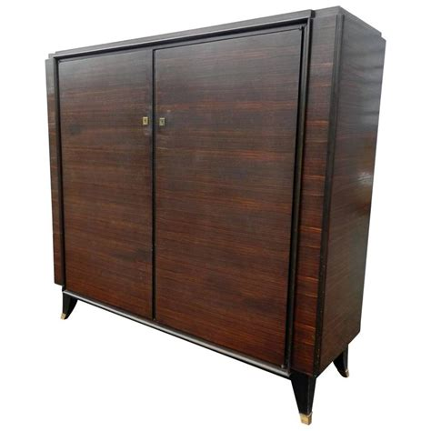 leleu style deco low rosewood and gilt brass armoire
