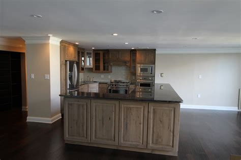 Stain Kitchen Cabinets Before And After gray knotty alder cabinets kitchen