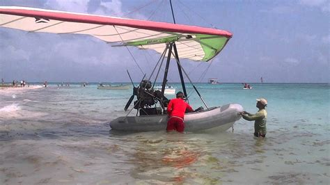 flying boat punta cana flying inflatable boat at ocean blue sand beach punta