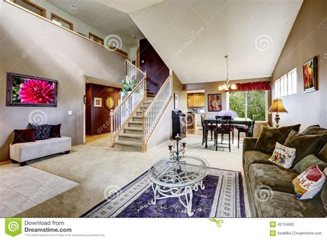 area of a room house interior with open floor plan living room with staircase stock photo image of inside