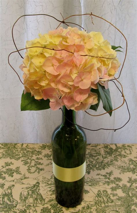 diy wine bottle with single hydrangea centerpiece