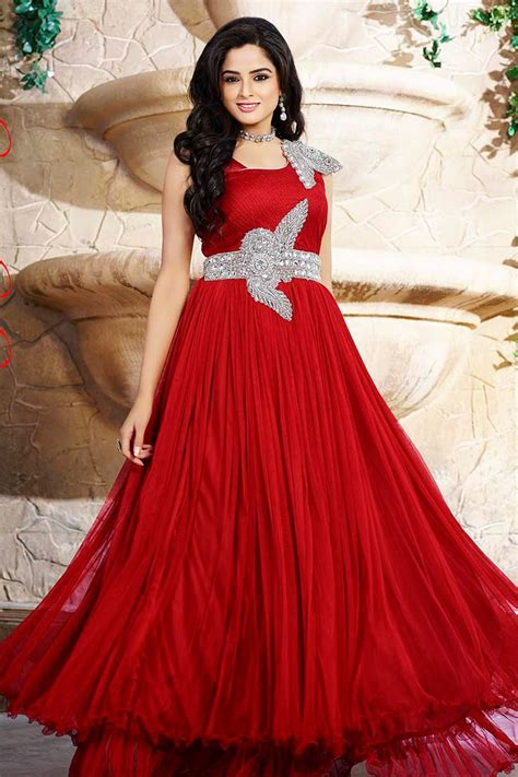 design of dress for party highly embellished brighten shade net party gowns
