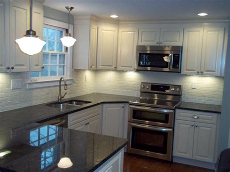 Black Pearl Granite White Cabinets by Psi Kitchen 2 Kraftmaid Montclair Biscotti Black Pearl