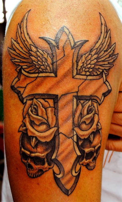 cross with wings and roses tattoo bicep cross ideas and bicep cross designs