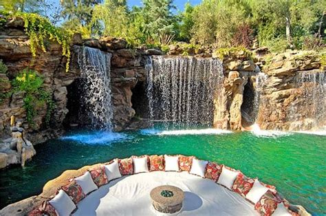 luxurious pool   waterfall   cave   lion