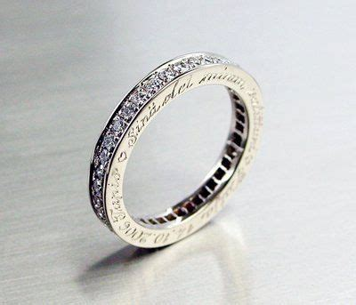 platinum eternity ring with engraving on the side