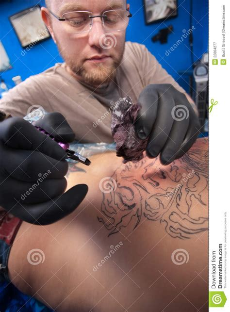 tattoo artist at work royalty free stock photography