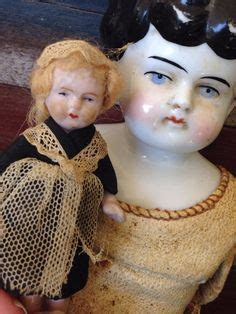 reproduction frozen dolls haunted doll reproduction antique bisque doll w stand