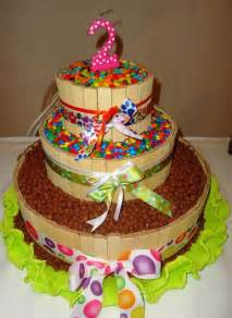 candy theme three tier second birthday cake with candies surrounding candy layers jpg hi res 720p hd