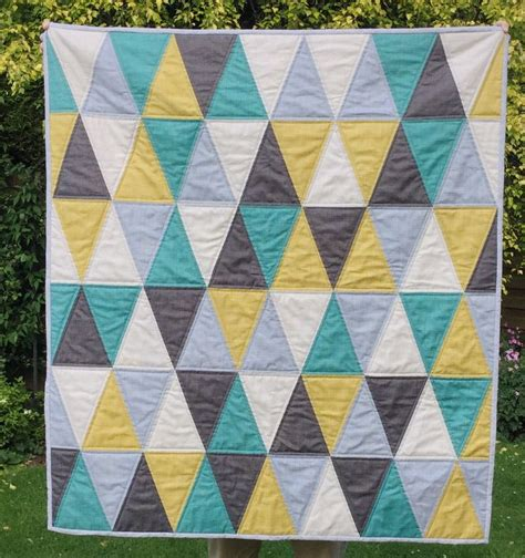 25 best ideas about triangle quilt pattern on