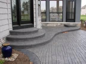 nice backyard concrete patio with steps stamped ohio concrete