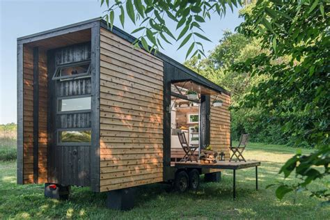 tiny home clad in burnt wood packs a ton of luxury into