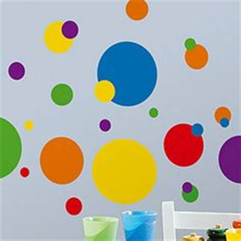 primary colors daycare animals and plants wall murals and cool table and chair in