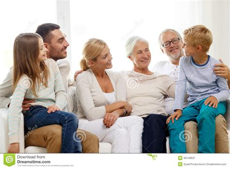 couch family happy family sitting on couch at home stock image image