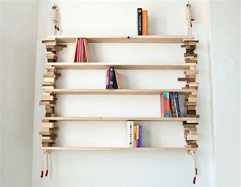 bookshelf built simply from waste wood blocks and rope