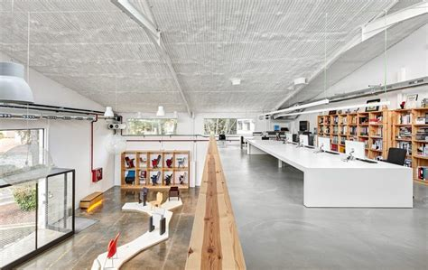 design center architects engineers consultants miriam castells renovates warehouse for figueras center in