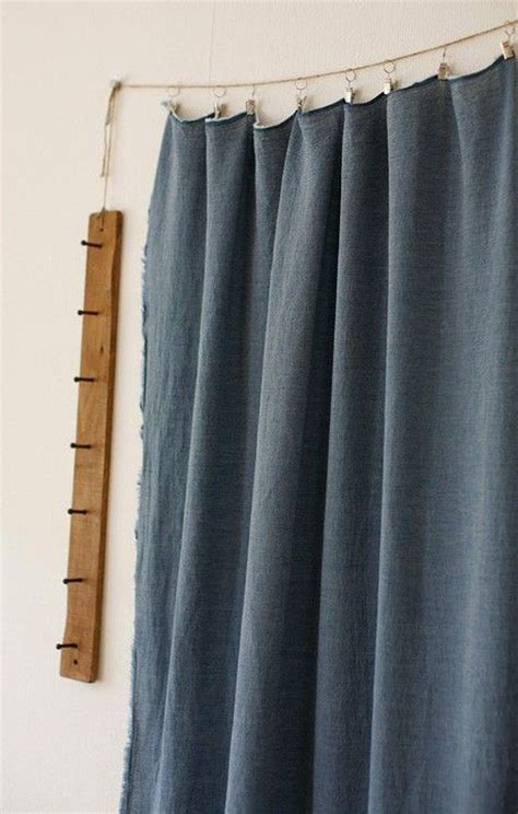 using tension rods to hang curtains use twine to hang curtains in the laundry room instead of