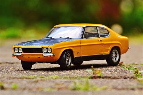 Classic Car Wallpaper Settings On Iphone by Yellow And Black Car In Tilt Shift Photography