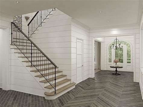 shiplap on stairs french country home with ship lap foyer and stairwell