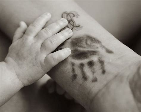 tattoo on finger while pregnant 25 kids handprint tattoos that are just too sweet