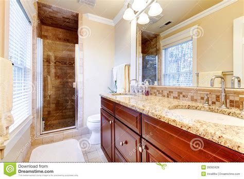Large Bathroom With Cherry Cabinets And Granite Countertop