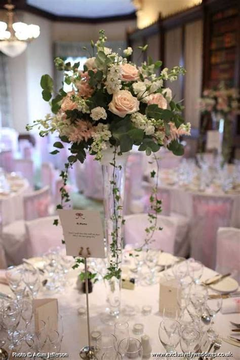 table display with pale blush pink roses white stocks and white hydrangea