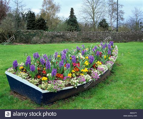 old boat flower bed boat planter stock photos boat planter stock images alamy