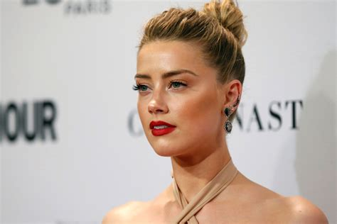 rumors amber heard going for big fish elon musk after amber heard and elon musk launch their relationship on