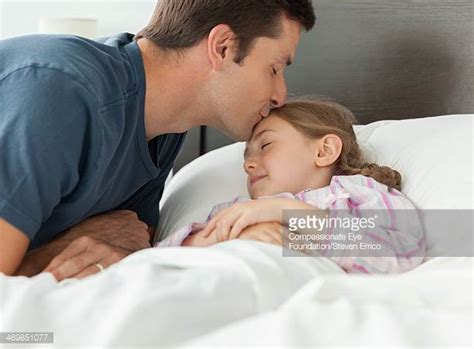 bedroom kissing kiss me goodnight stock photos and pictures getty images