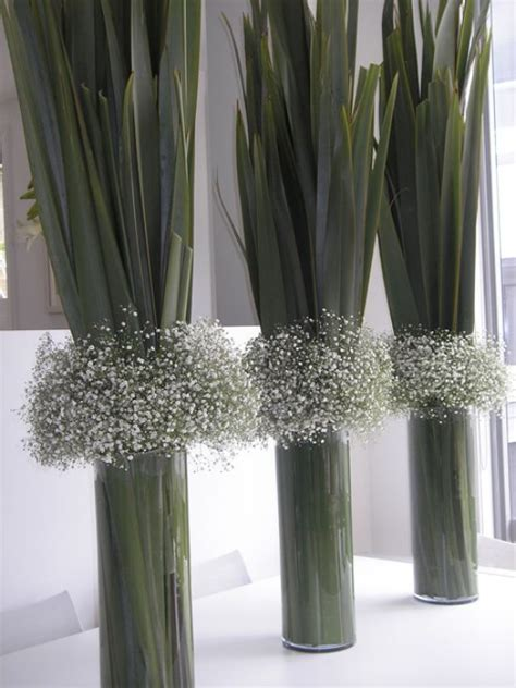 real simple ideas for simple glass vases by kimberly reuther designspeak baby s breath and flax leaves in glass vases bold and
