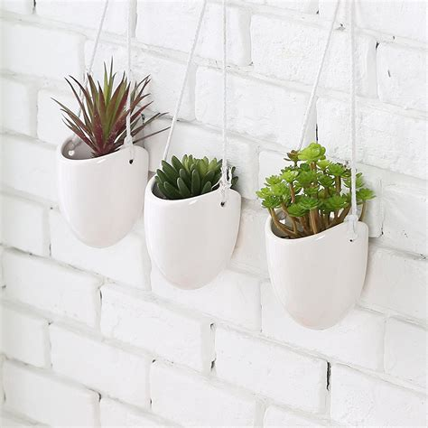 wall garden pots modern planters hang your plants from the ceiling walls the architects diary
