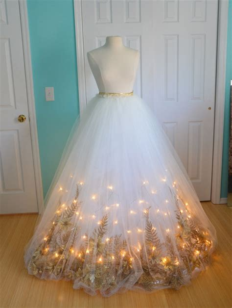 light up dress she glues garland to the hem of a dress when