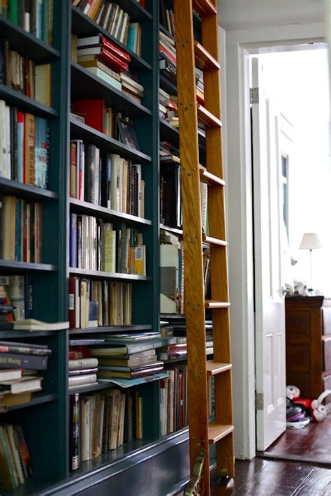 i ve always wanted a wall of books with a ladder so cool