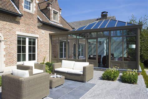open veranda orangerie met zithoek open haard en bureau de mooiste