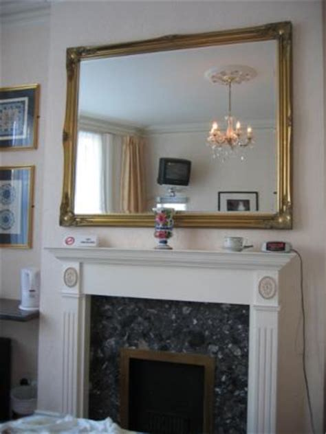 mirror above fireplace on fireplace furniture