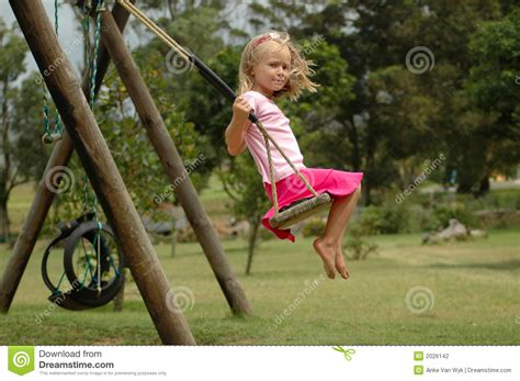 swinging with child swinging stock photo image of female children
