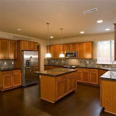 what color laminate flooring with oak cabinets can i have this kitchen in dark oak or cherry wood lol
