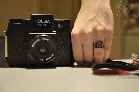 small camera tattoos small on finger