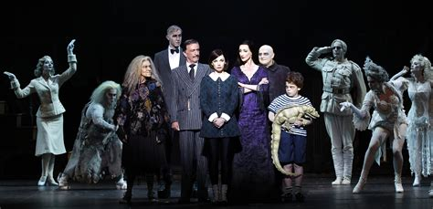 addams family the addams family review sydney simon parris man in chair