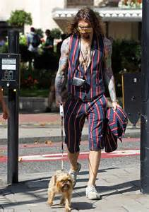 justin hawkins rocks a garish pin striped look while