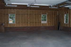 Custom Homes Greenville Sc 2 car garage with brick foundation