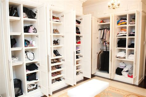 Shoe Closet With Doors Walk In Closet With Paneled Bi Fold Wardrobe Closet Doors Transitional Closet Pull Out Shoe Cubbies Design Ideas