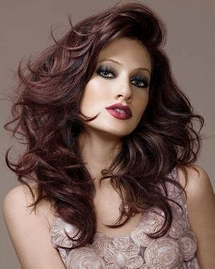hair cuts to increase curl and volume long big volume curly hair style brown red mahogany colour
