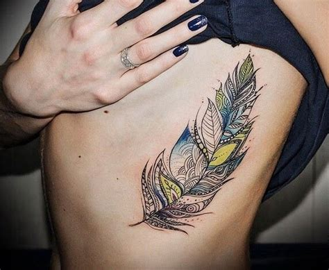 feather rib tattoo interesting colorful tribal feather on rib side