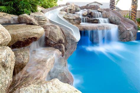 backyard grotto backyard oasis pool spa swim up bar grotto slides water features